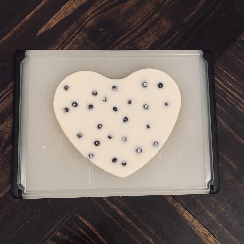 unmolded frozen yogurt bark in the shape of a heart with graham cracker crumb side down