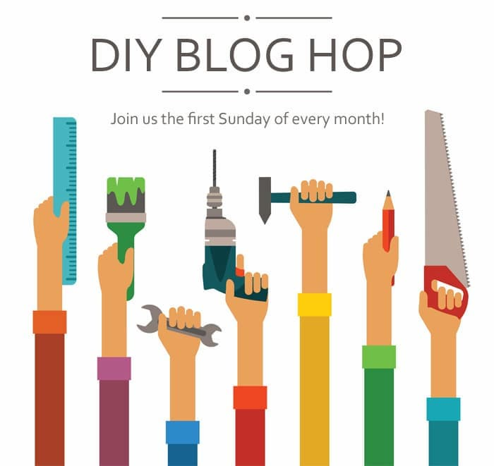 """Cartoon image of arms reaching up holding different DIY tools and wearing different colored shirts with the title above that reads, """"DIY Blog Hop, Join us the first Sunday of every month!"""""""